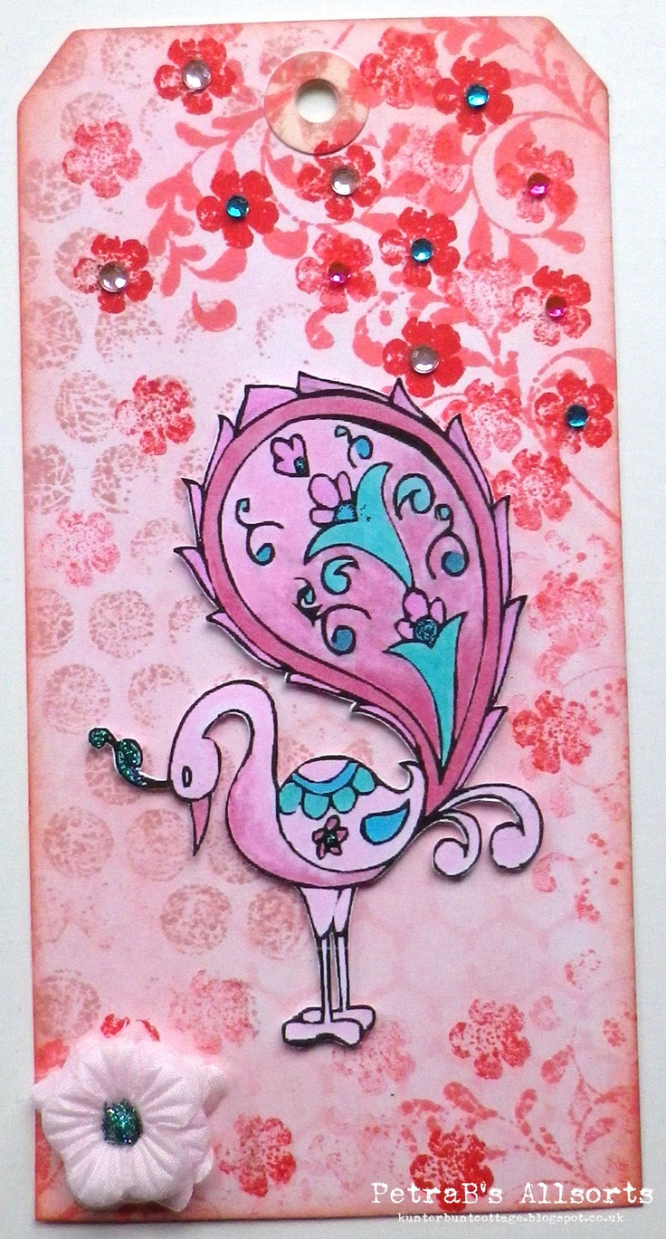 Shades of Pink. white tag stencilled and stamped - various distress inks - stamps: Eline Pelinkhof, Kaiserkraft - little blings, fabric flowers, Stickles - image: Digi Darla