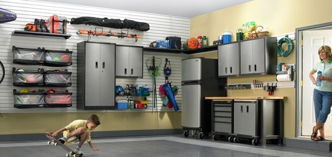 Nicely organized garage with use of wall cabinets and peg board system