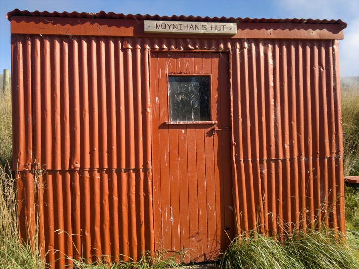 one of the many red huts on the Central Otago Rail Trail, New Zealand.