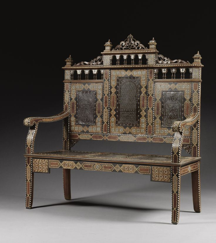 A NASRID REVIVAL MICRO-MOSAIC CHAIR-BACK SETTEE, SPAIN, 19TH CENTURY of typical rectangular section, standing on four legs, the seat and back rest applied with six leather panels, tooled with foliate and architectural designs and inscriptions,inscriptions  On two of the leather panels on the back rest:  wa la ghalib illa Allah  'And there is no conqueror except God'  Estimate  6,000 — 8,000 GBP  9,810 - 13,080USD LOT SOLD. 7,500 GBP (12,263 USD)