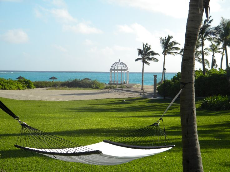 Hammock at Sandals Emerald Bay, Exuma Bahamas. Wonderful spot to relax in and the gazebo in the back is a perfect spot for a beach wedding!   #sandals #beach #resort #bahamas #caribbean #pool #honeymoon #hammock #travel #exuma #sunbathing #relaxing #couples #wedding #weddingceremony