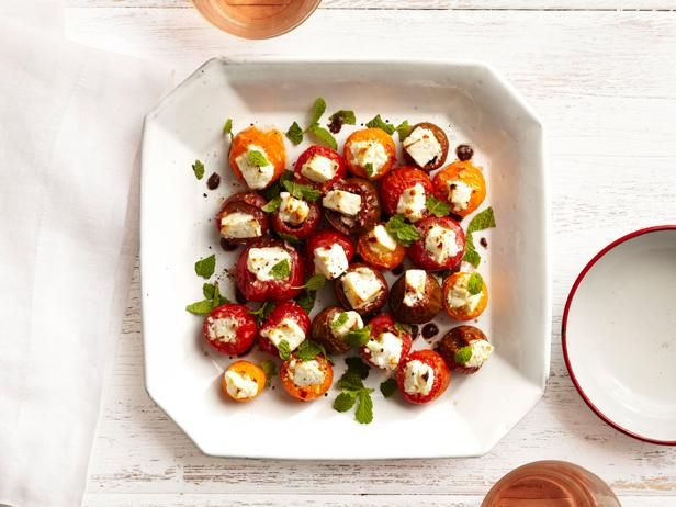 Stuff fresh cherry tomatoes with feta cheese and spices for a super easy, perfect-for-any-party appetizer.