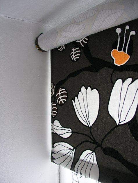 http://www.designsponge.com/2010/06/sewing-101-roller-blinds.html    How to make a fabric roller shade.  So much nicer than plain white!