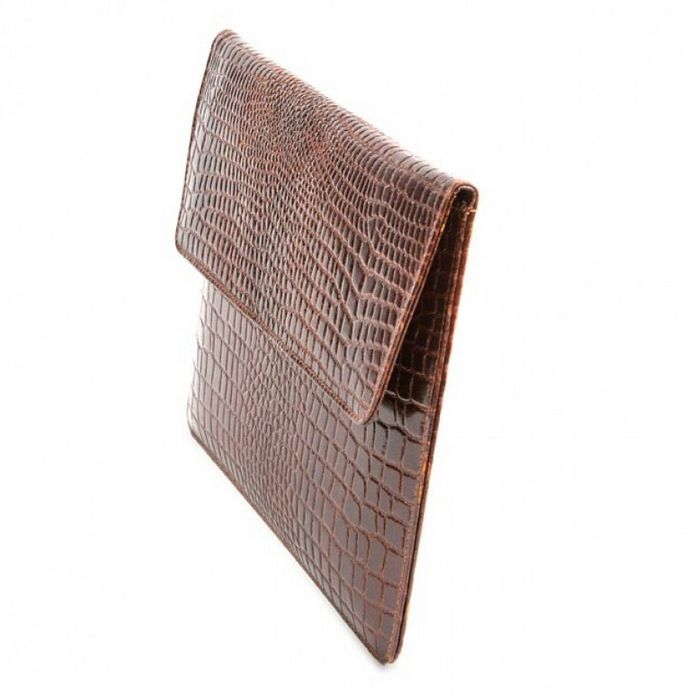 Crocodile brown leather envelope availabe for both iPad as well as iPad mini. Price: $70-80. More information: www.dbramante1928.com