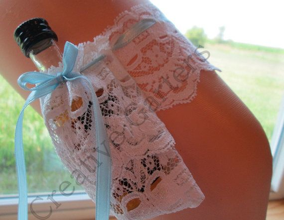 Handcrafted Garter that can hold a mini shooter bottle of alcohol.