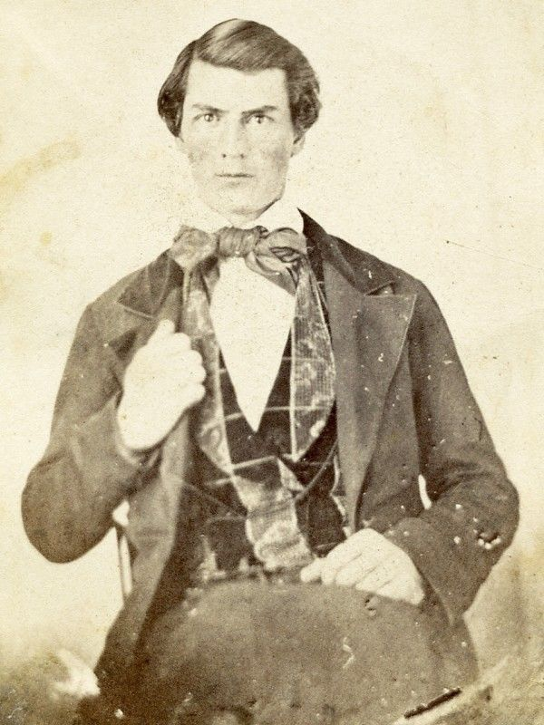 Vintage, original albumen photograph on CDV from the 1860s from an earlier image, likely an ambrotype, of a handsome young man, from an Ottawa, Illinois, album, and in near fine condition as such.