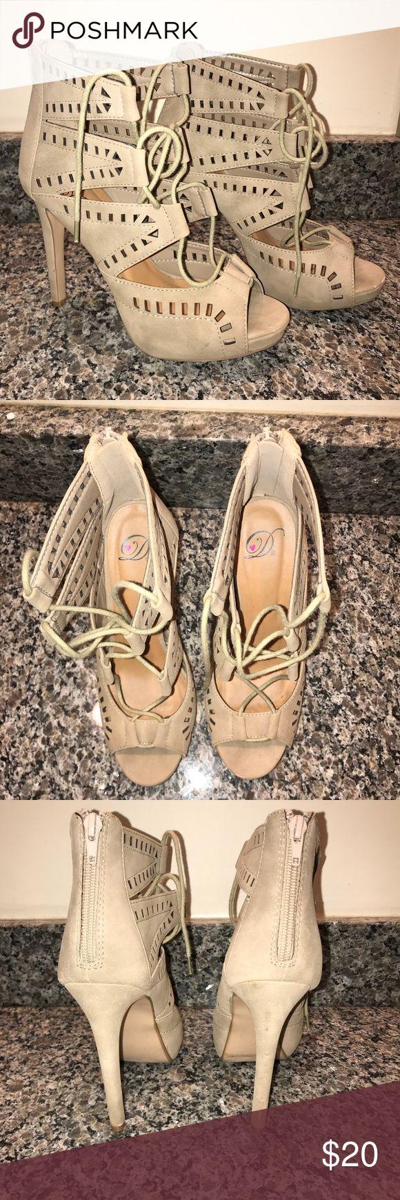 High heel platforms Pair of beige suede laser-cut heels with a zip-up back. Size 7 1/2. Shoes Platforms