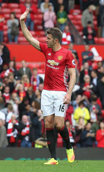 Michael Carrick of Manchester United salutes the fans at the end of the Premier League match between Manchester United and Leicester City at Old...