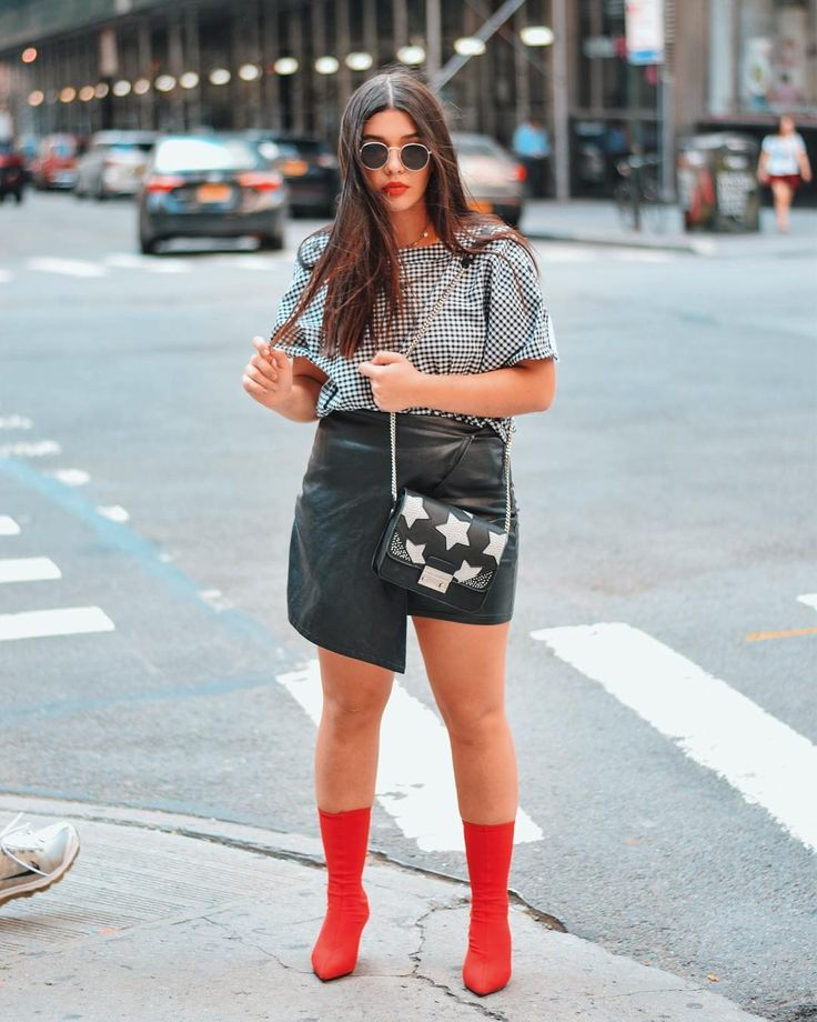 Tina Prokas wearing black mini skirt, with bright red boots, cross bodybag, gingham t-shirt,red lips, new york street style , pop of red, bright red, bright colors