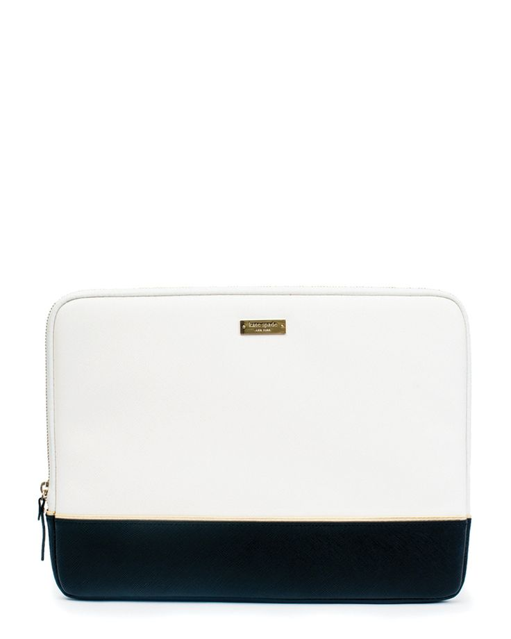 """Work and travel have never looked better with the Kate Spade New York Saffiano Laptop Sleeve for 13"""" MacBook. Crafted in smooth Saffiano textured leather with a gold zipper detailing. The sleeve is as"""