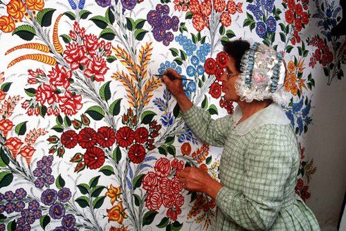Kalocsa is 120 km far from Budapest , the capital - it is in the South by the Danube .  The tradition of wall painting and embroidery on home decor and apparel is still a living tradition .