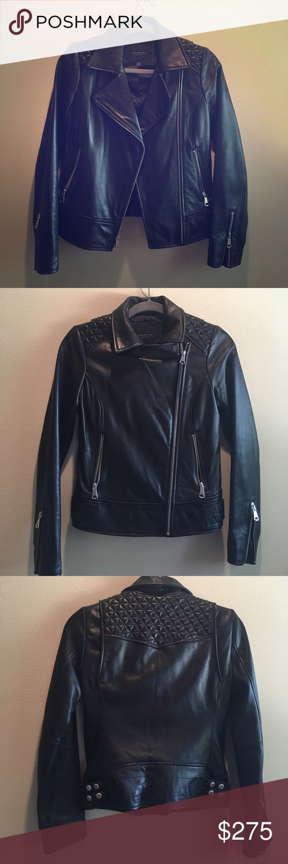"""Marc New York Leah Leather Moto Jacket Sleek leather styled in a bold design for the perfect statement in your next night out. Wing collar, zipper front, long sleeves with zipper details at cuff. Zip pockets at waist, quilted detail on shoulder. Approx 21"""" length. Genuine leather shell. Hidden inside pocket in lining! Andrew Marc Jackets & Coats"""