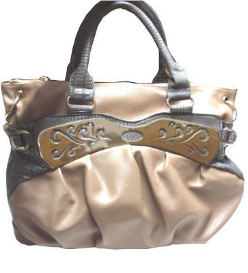 Large silver plate on the front pocket, nude colour bag with long and short handle._fashion woman accessories.