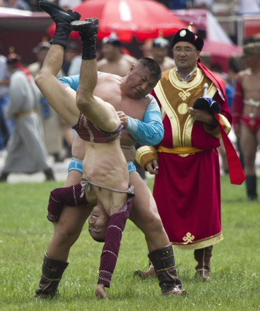 "Wrestling is one of three major ""manly"" events at Mongolia's annual Naadam Festival. The other two are archery and horse racing. We'll be seeing this in July! www.TheTripStudio.com"