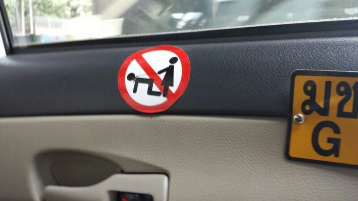 """No leash on the husband please.  Do it at home,  but spare him in the cab"". Sign inside a Bangkok cab seems to say (Courtesy Abhijeet Powdwal)"