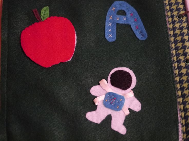A is for Apple (the top lifts to reveal tiny seeds made of little brads), Astronaut, and Alexander (my son's face is under the black part of the helmet)!