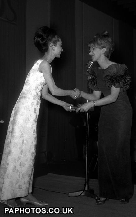 """1964 Wendy Craig receives from film star Audrey Hepburn her British Film Academy award as the """"Most Promising Young Actress"""" at the Annual Academy Awards dinner at the Hilton Hotel."""