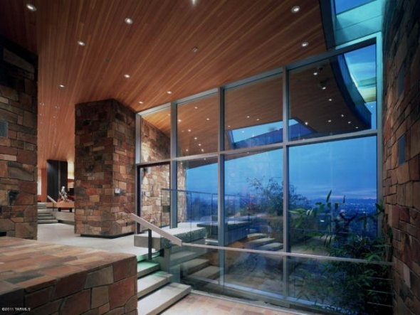 We love how the glass and stone complement each other throughout the house.