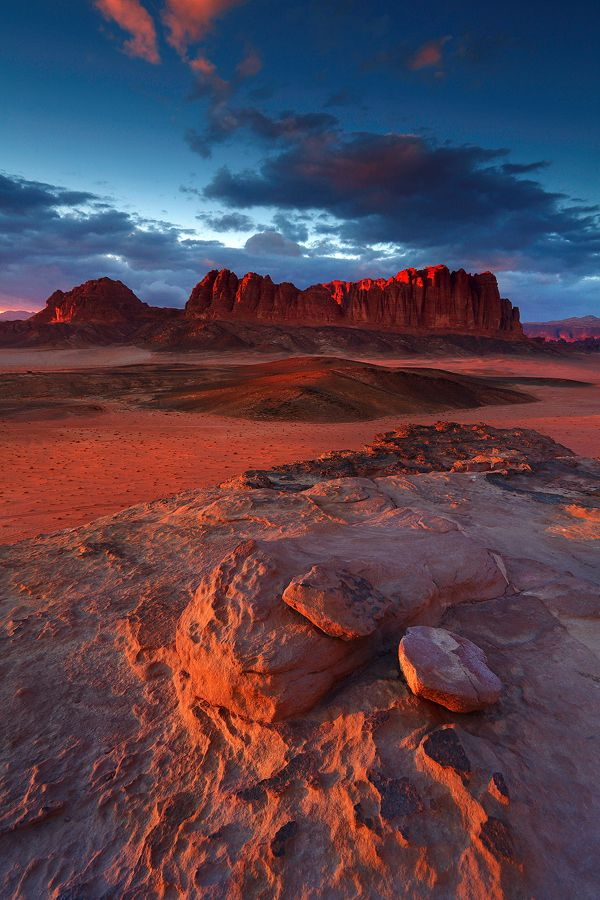 Wadi Rum Sunset in Jordan. Dramatic desert with extraordinary rock formations. Take a jeep tour.