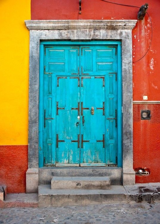 did i mention my insane love for hand-crafted doors? and if it's turquoise..sigh..a girl can dream