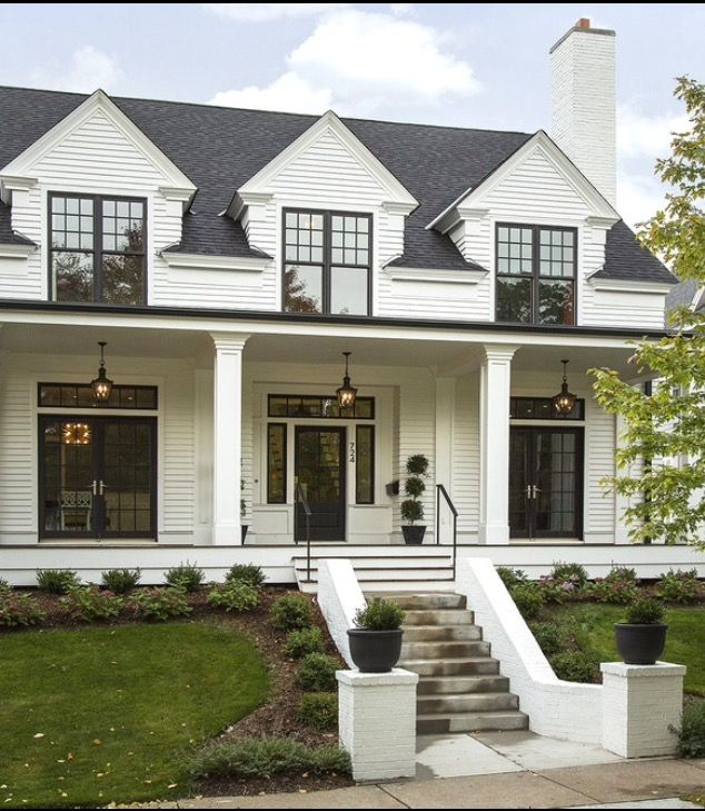 A grander look for the front. Raise the porch roof to second floor window sill level gives more light to the main floor. When we level the floor in the front bedroom raise the ceiling and dormer the window.