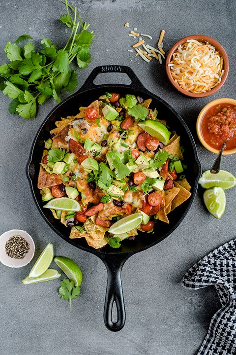 INGREDIENTS BY SAPUTO | For an easy Mexican recipe idea to spice up your next get together, try our chorizo, black bean and avocado nachos with coriander. Our tip for making them irresistible? A (very) generous sprinkling of Saputo Taco Nacho cheese!