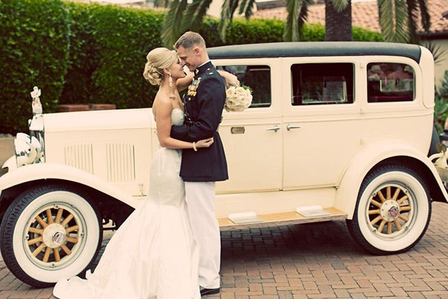 Vintage getaway car and an elegant black and white wedding
