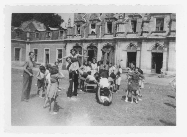 Children perform gymnastic exercises in the yard of the Rothschild's Chateau Ferriere, where they are attending a summer camp sponsored by OSE.