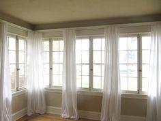 $5 DIY Curtains made from basic flat sheet found at Wal-Mart. What a steal! Cheaper than fabric; all you have to do is split and cut along already hemmed edge to hang on curtain rod for a flawless simple curtain.