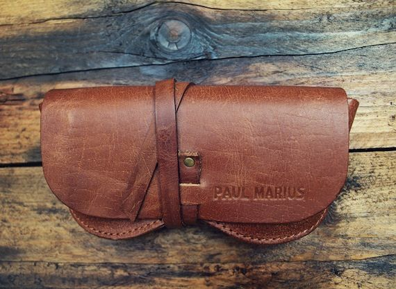 Designed to last from bad aviator decisions right through until spectacle hunting season.  http://sorrythanksiloveyou.com/accessories/outdoors/leather-sunglasses-wrap-paul-marius