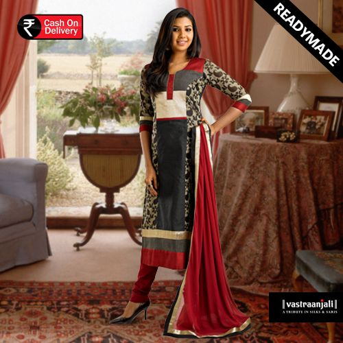 Black and Red Churidhar kurta set.  The paneled woven brocade and black chanderi kurta has designer round neck, ¾ sleeves with a smocked piping at the edges. This straight kurta has an overlay of smocked fabric at the hemline. Maroon Churidhar pants has a drawstring waistband. The dupatta is in chiffon with golden tissue and black taping on all four sides.  For more details and online shopping visit www.vastraanjali.com