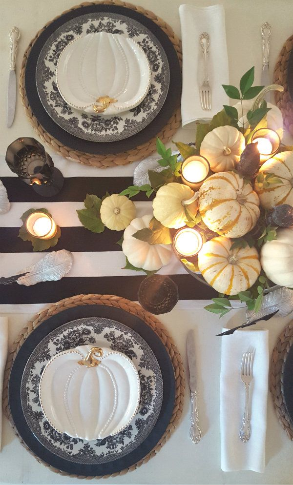 Halloween is one of my favorite times of the year.  Setting an black and white table is the perfect way to host an elegant dinner party.