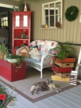 Kelsey... one of the old wooden crates for your programs to go along with the old mailbox!?!  Sweet cottage porch !