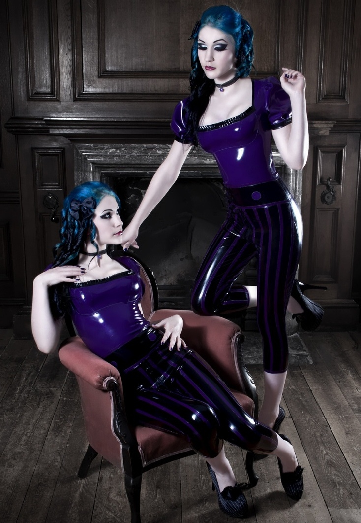 Sexy babes in matching purple and black leather costumes