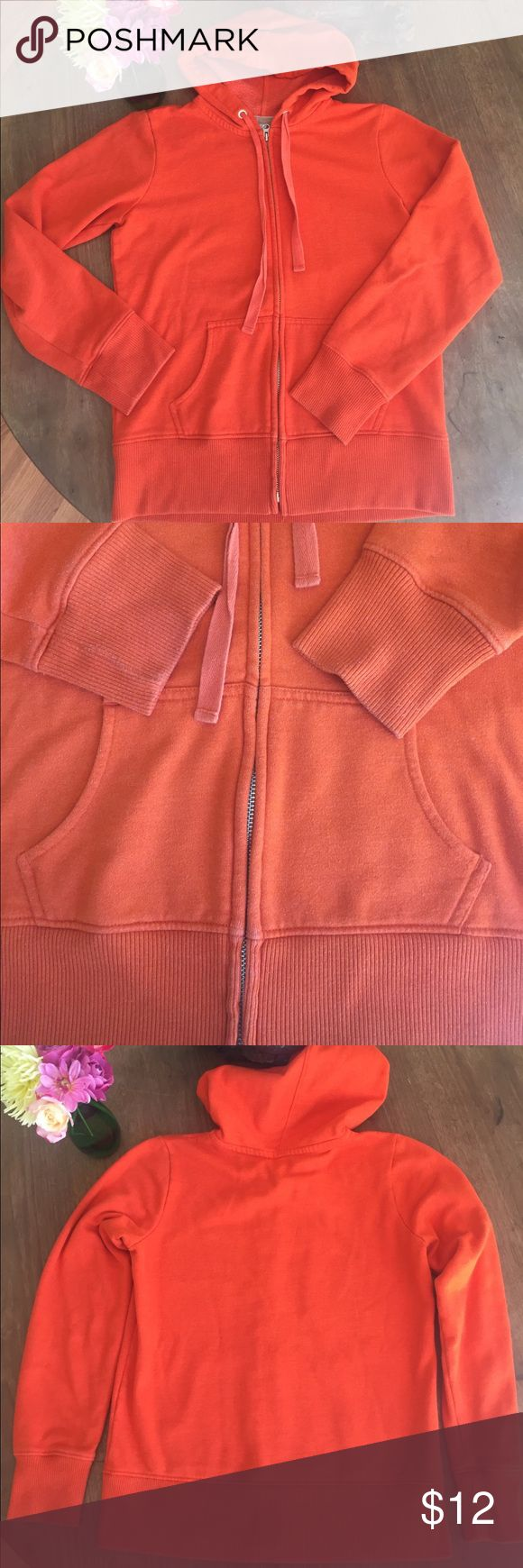 Old Navy zip up hoodie Orange Sz Med Great basic for end of summer and fall. Very slight pilling on the cuffs and then very minimal throughout. Slight fading on edges as you see. Still very soft and bright. Old Navy Tops Sweatshirts & Hoodies