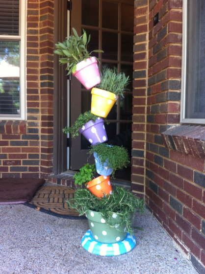 My DIY Instructions for a Tipsy Plant Tower - love the paint job on this one ...adorable!
