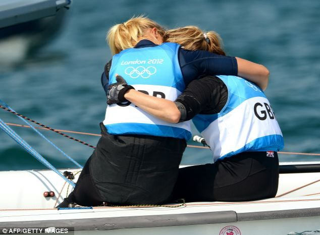 Great Britain's Hannah Mills (R) is hugged by teammate Saskia Clark