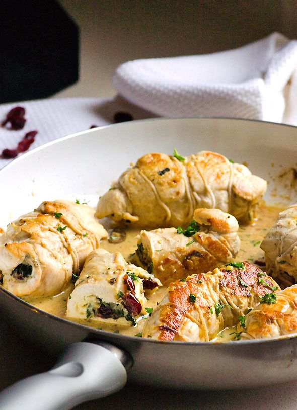 Chicken Stuffed with Brie, Spinach and Cranberries - Clean eating approved simple and yet fancy chicken recipe. Moist, flavourful and juicy.