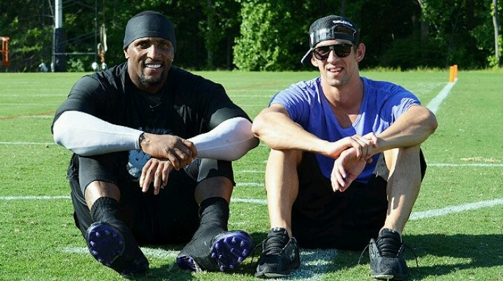 GREATEST LINEBACKER EVER AND THE GREATEST OLYMPIAN EVER ON THE SAME FIELD .RAY LEWIS AND MICHAEL PHELPS. WE BLEED PURPLE HERE RAVENS NATION !