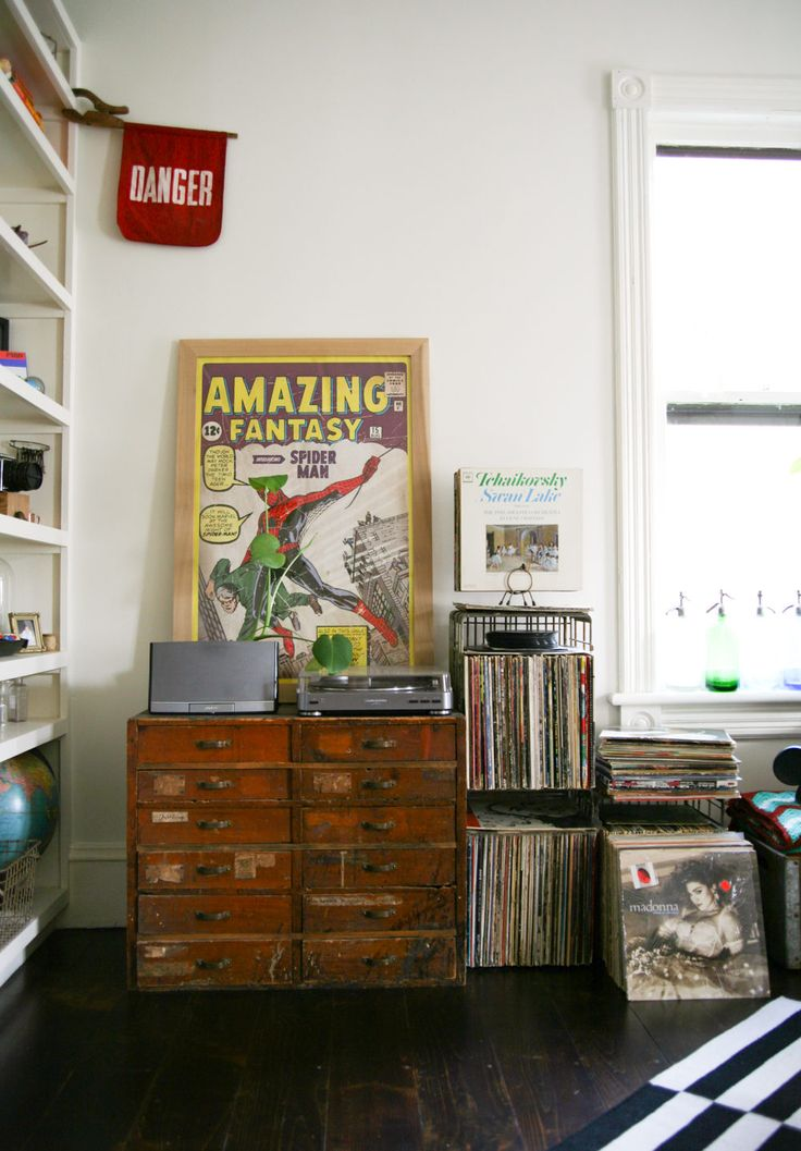 One nook in the parlor is devoted to the couple's record collection. There are hints of Mike's love for comics throughout the house, like the Spiderman poster that rests above a vintage chest of drawers.