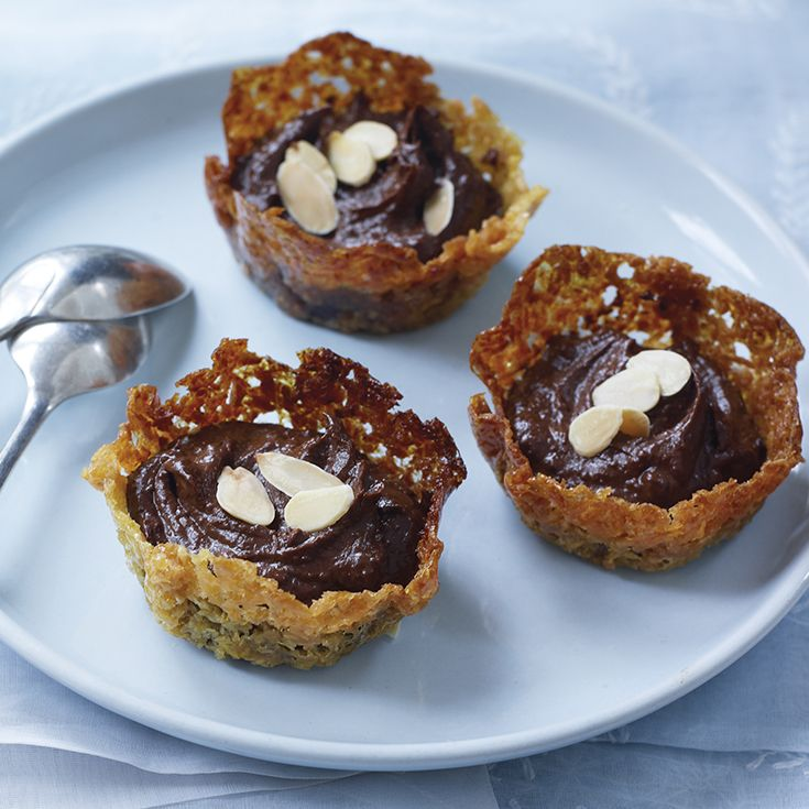 Gluten-free and dairy-free chocolate and orange mousse with coconut snaps. Find the recipe on the Waitrose website.