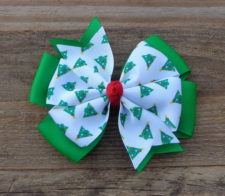 Christmas Hair Bow~Christmas Tree Bow~Christmas Boutique Bows~Holiday Hair Bows~Green Hair Bow~Large Boutique Bow~Pinwheel Hair Bow~Hair Bow by LizzyBugsBowtique on Etsy https://www.etsy.com/listing/207989867/christmas-hair-bowchristmas-tree