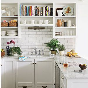 Creative Cabinet Ideas | Open Cabinets | SouthernLiving.com: Idea, Open Shelves, Subwaytil, Open Cabinets, Small Kitchens, White Subway Tile, Subway Tiles, Open Shelving, White Kitchens