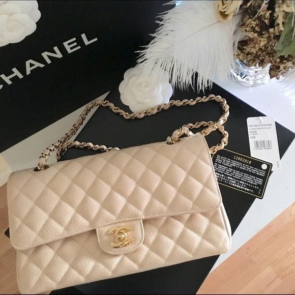 CHANEL Classic 2.55 Double Flap Bag Brand: Chanel Style: 2.55 Flap Type: Shoulder Crossbody  Size: Medium Measurements: L10 x H6 x W3 inches Color: Light Beige with gold hardware  Condition: Very good preloved Disclosures: One blue dot & small indentation inner flap. Faint scratches on hardware  Original sleeper bag, tag & authenticity card included Retail: $4900 plus tax   Lower prices on Veblenx.com CHANEL Bags Shoulder Bags