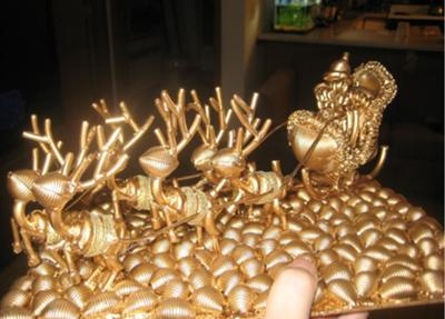 Macaroni Art Sleigh: I want to share my wife's amazing macaroni art project that she made this year for Christmas.  My wife sat there for 5 days and made Santa's sleigh and