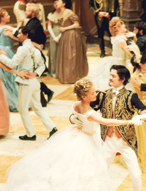 Cinderella and Elliot at the ball where they fall in love and meet Keeley and Patrick- the fairy godmother and the leader of the rebellion