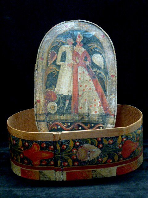 A well decorated German bride's box with two figures and tulips around the side.Late 18th century. 18in by 12in by 8in