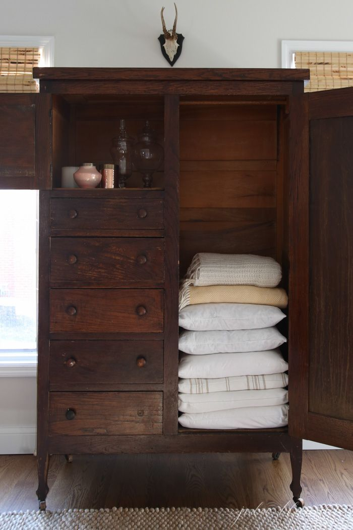 Older homes often have small closets - create additional storage with furniture - like this wardrobe linen closet