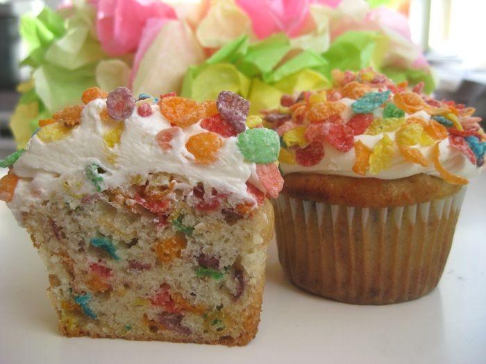 Banana cupcakes full of Fruity Pebbles, topped with malted milk buttercream