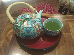 Genmatcha beau-tea-fully presented in a decorative teapot, accompanied by a matching cup and small yet delicate little tea tray in Edward Street, Brisbane (http://niginigi.com.au/)